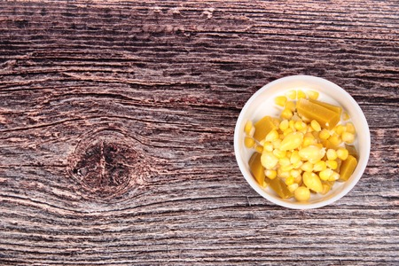 Thai Chinese dessert ,Delicious streamed sweet corn ,pumpkin and ginkgo in coconut milk .  Have a copy space in left. Archivio Fotografico