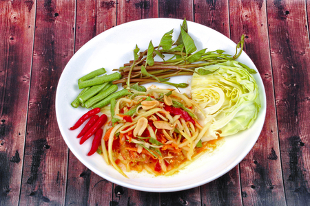 Chinese Vegetable festival as spicy papaya salad with mixed vegetable call Som Tum J in Thai . Stock Photo