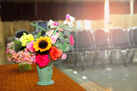 Prepare a beautiful flower put in vase. For decoration and layout of the meeting room to be refreshing and comfortable before the start of  seminar meeting