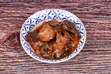 Traditional Thai herb recipe,Curry pork with Chamuang (Garcinia cowa) leaves,Local Thai food call as Gang moo cha muang.