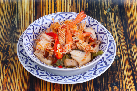 Thai recipe ,Tom Yum fresh prawn with milk and sliced coconut. Thai Spicy and sour prawn soup  call Tom Yum Kung Num Khon in Thai as mixed herb in soup with coconut milk . served on wood