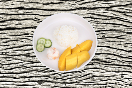 Thai traditional food, Jasmine rice with vegetables and fruits as mangosteen, mango and cucumber.