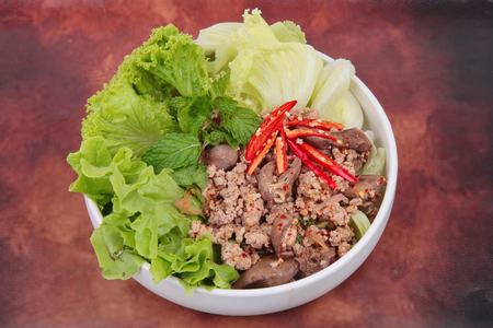 Popular Thai food ,Sliced grilled beef salad ,Spicy and sour mixed herb salad with minced pork and chicken topped mixed vegetable. 写真素材