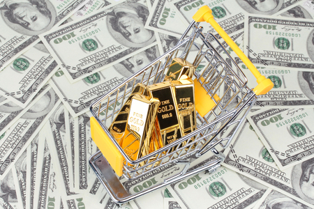 6 Gold bars 1 kg, in shopping  trolley with yellow mark for supermarket paced on bank note.