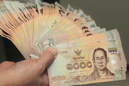Use hand wipes 1000 Baht of Thailand banknotes