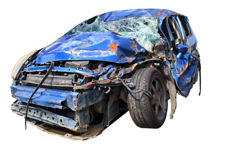 Blue car wreck that has suffered major damage.
