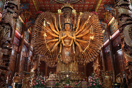 Kanchanaburi.Thailand,Jan 24,2019 ,Take photo  large Guan Yin Bodhisattva carved from wood 12 meters high in Wat Metta Photiyan , A Buddhist temple in Chinese style in Thailand. Editorial