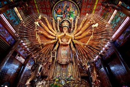 large Guan Yin Bodhisattva carved from wood 12 meters high in Wat Metta Photiyan, A Buddhist temple in Chinese style in Thailand.