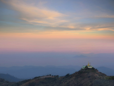 Golden pagoda on hill with landscape view in colorful morning sky in Myanmar. This Photo contain Noise and Burry.