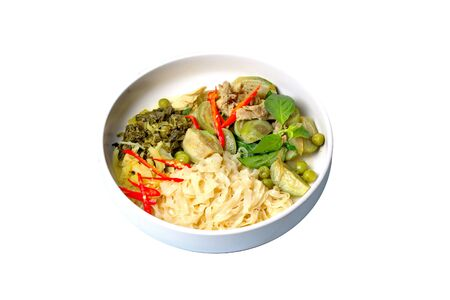Isolated of popular Thai food, Chinese noodle with green chicken curry in coconut milk topped minced pickle lettuce.