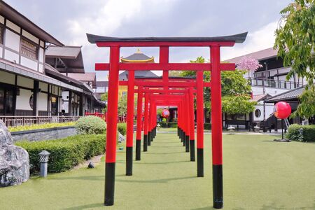Row of red torii at J Park,Chonburi,Thailand.