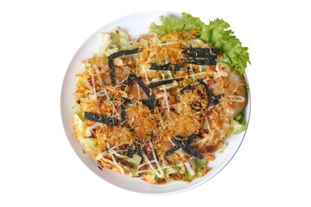 Homemade Okonomiyaki (Japanese Cabbage Pancake) Recipe is fried mixed vegetable flour with meat topped sweet sauce ,mayonnaise and sliced dried yellowfin tuna  served on wood.