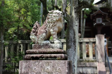 Shisa or Shishi ,Imperial guardian lions image in Japan,The male lions jaw image for  becky fortune came at Higashi Tenno Okazaki Shrine ,Kyoto,Japan. Selective focus.
