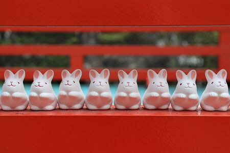 Lovely little white rabbit statue was placed in front of an outdoor Higashi Tenno Okazaki shrine, Kyoto,Japan 版權商用圖片
