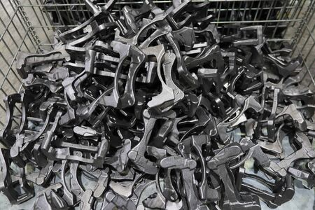 Product of processimg as casting steel  place in streel basket within working area. 版權商用圖片