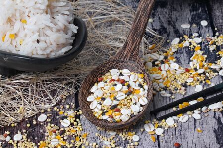 Traditional  cereals for cooking with rice from Japan and  Thai jasmine rice that has been cooked on old wooden pattern.