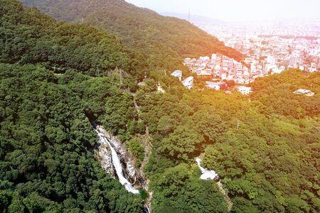 Nunobiki waterfall on mountain at Rokko forest and  Kobe cityscape . 版權商用圖片