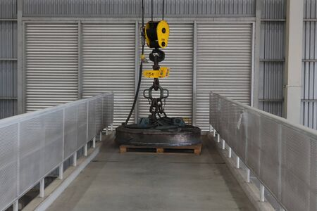 5 Tons magnetic crane placed on access way between the raw materials storage.