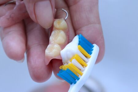Use the toothbrush to clean teeth partial denture.