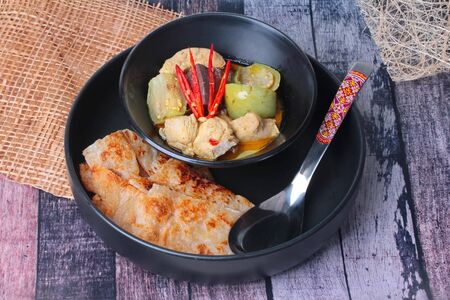 Ready served of Roti , Indian food as deep fried flour ,with Thai green curry isolated on background.