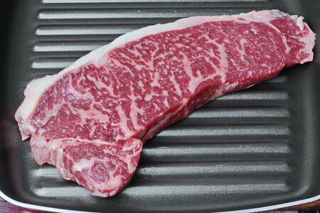 Ready raw fresh steak as wagyu beef  MS5+  in double side pan. Stock fotó