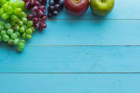 nature fruits set on blue wooden background Stock Photo