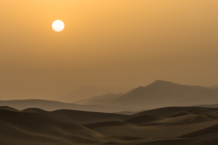 Silhouette of sunset on the desert in Xinjiang, China Stock Photo