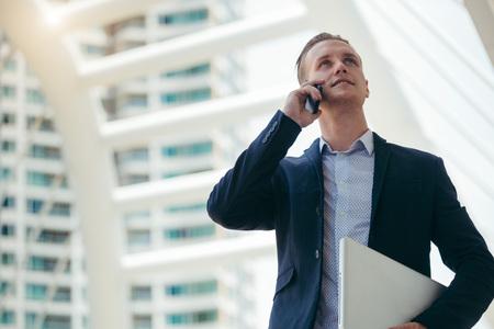 smile caucasian business man use smart phone talking Stock Photo