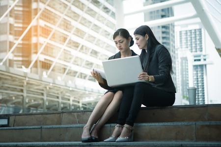 business meeting outdoor between asian women