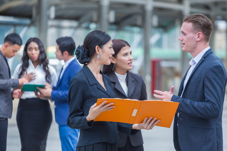 International Business peoples talking outdoor Stock Photo