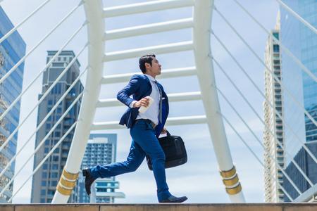 Business man run to work in rush hour