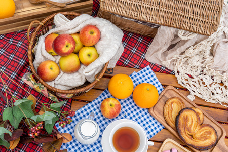 Picnic items setting in a park, contain many fruit and bakery Reklamní fotografie