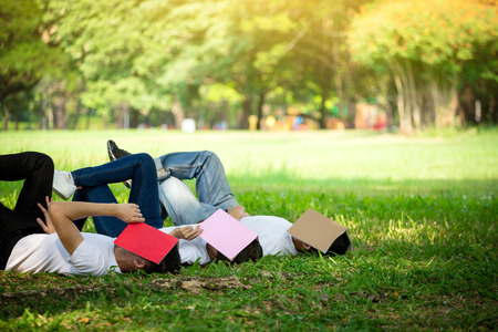 Group of peoples sleep with book on face because of study hard