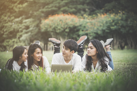 group of peoples meeting in park by use laptop for teamwork