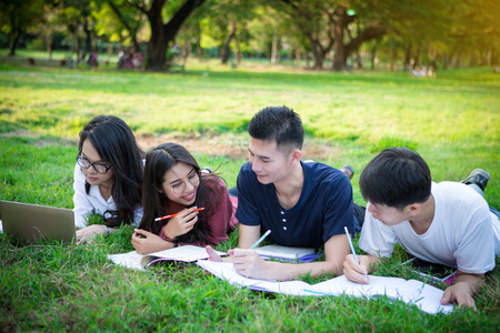 group of high school student learning in a park together
