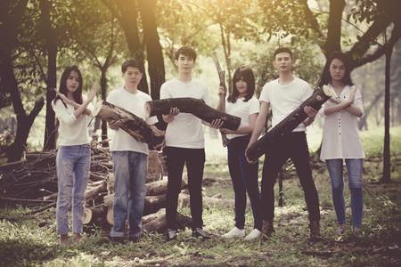 group of teenage student refuse cut the tree , love the earth and nature concept Reklamní fotografie