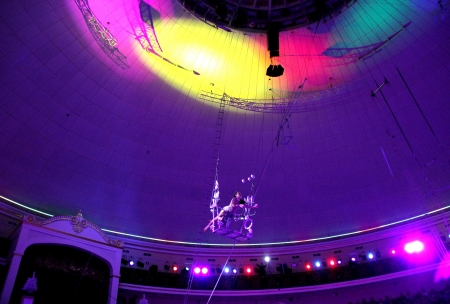 Minsk, Belarus, Belorussian State circus, 2012 circus performance  January 7  2012: an acrobat under the roof of circus Stock Photo - 15741232
