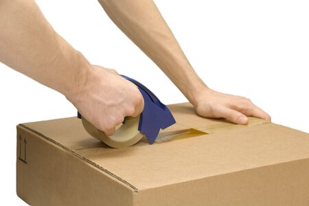 pack: Male hands taping up a packet, isolated on pure white