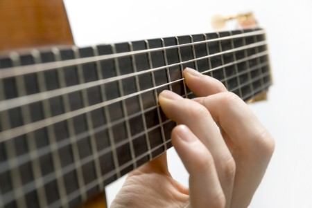 hand movements: Classical guitars fingerboard with playing hand Stock Photo