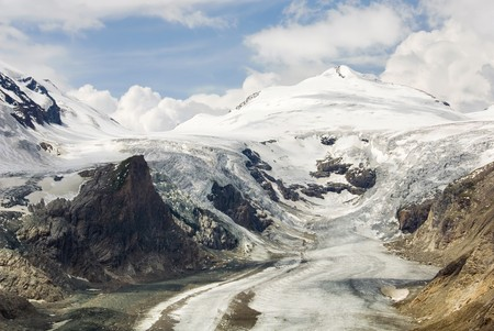 Impressive mountain scenery with Austrias highest glacier shrinking because of global warming. photo
