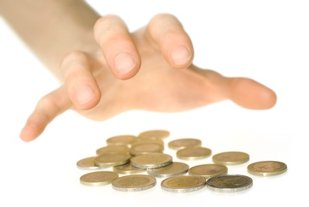 greedy: Hand reaching for coins in a greedy manner Stock Photo