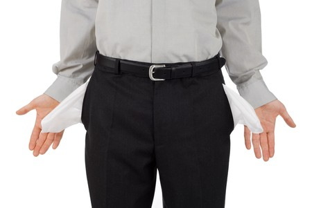 insolvency: Broke businessman shows his empty pockets, isolated on white