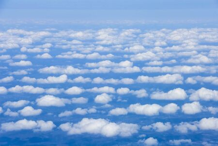 Birds eye view of clouds and blue earth photo