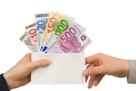 lucrative: Isolated studio shot of Euro notes in an envelope being handed from one person to another Stock Photo