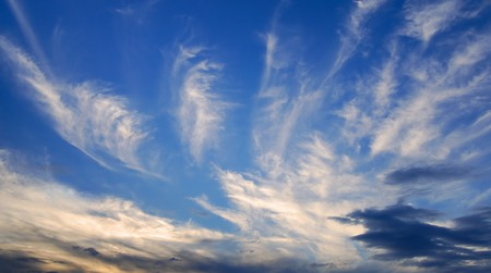 Beautiful cirrus clouds in the deep blue evening sky photo