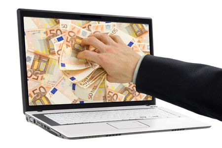 lucrative: Conceptual shot of businessman�s hand taking out euro banknotes out of a laptop display