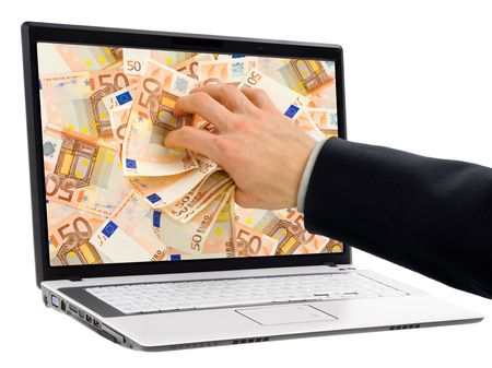 Conceptual shot of businessmans hand taking out euro banknotes out of a laptop display