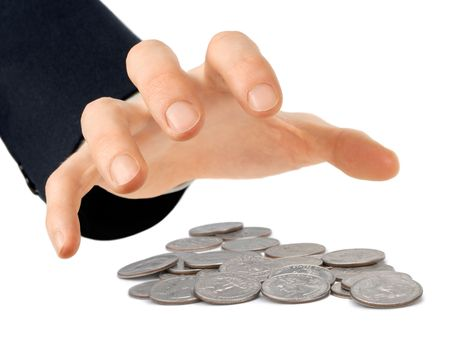 miserly: Businessmans hand reaching for a heap of quarters, isolated on white