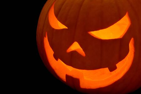 Halloween pumpkin with evil grin, isolated on pure black Stock Photo - 5615140
