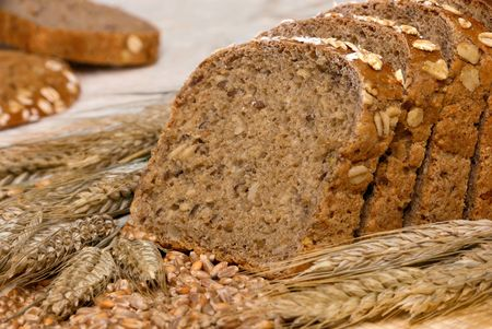 Slices of finest organic bread decorated with natural cereals photo